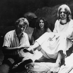 """Producer-director Norman Jewison, left, demonstrates how he wants an actor to wash the feet of Jesus, portrayed by Ted Neeley, during filming of the movie version of the rock musical, """"Jesus Christ Superstar."""" The film was shot in Bethlehem, Israel, on Oct. 8, 1972."""