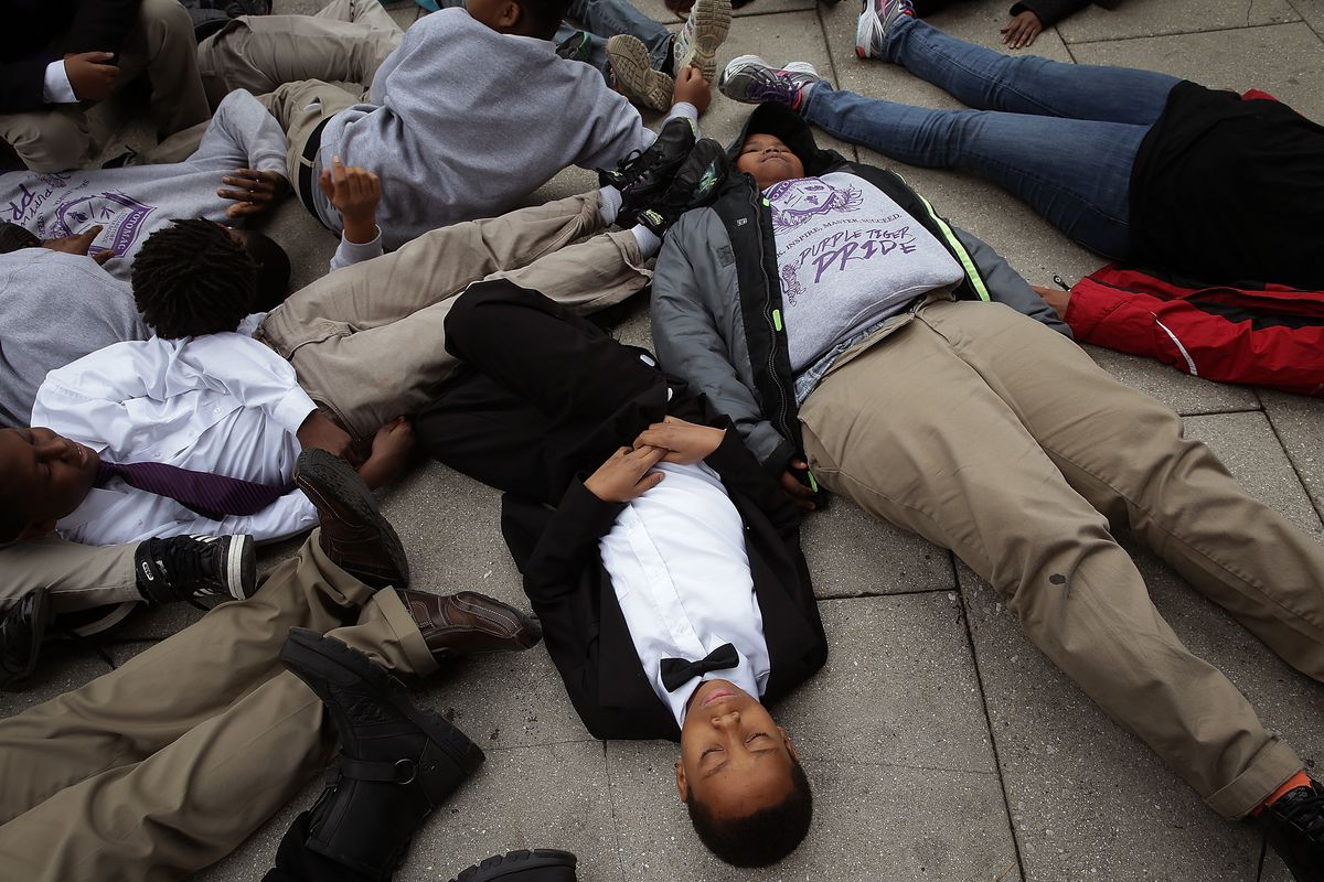 "Schoolchildren participate in a ""die-in"" for Michael Brown."
