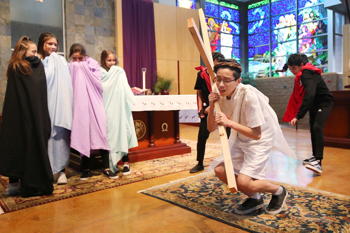 Gerardo Delgado, right, and other St. John the Baptist Middle School students reenact the Stations of the Cross in Draper on Tuesday, April 16, 2019. The Stations of the Cross refers to a series of images depicting Jesus Christ on the day of his crucifixi