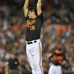 Baltimore Orioles pitcher Wei-Yin Chen wipes his face in the fourth inning of a baseball game against the New York Yankees Friday, Sept. 7, 2012, in Baltimore. Chen gave up five runs in the inning, including two home runs.