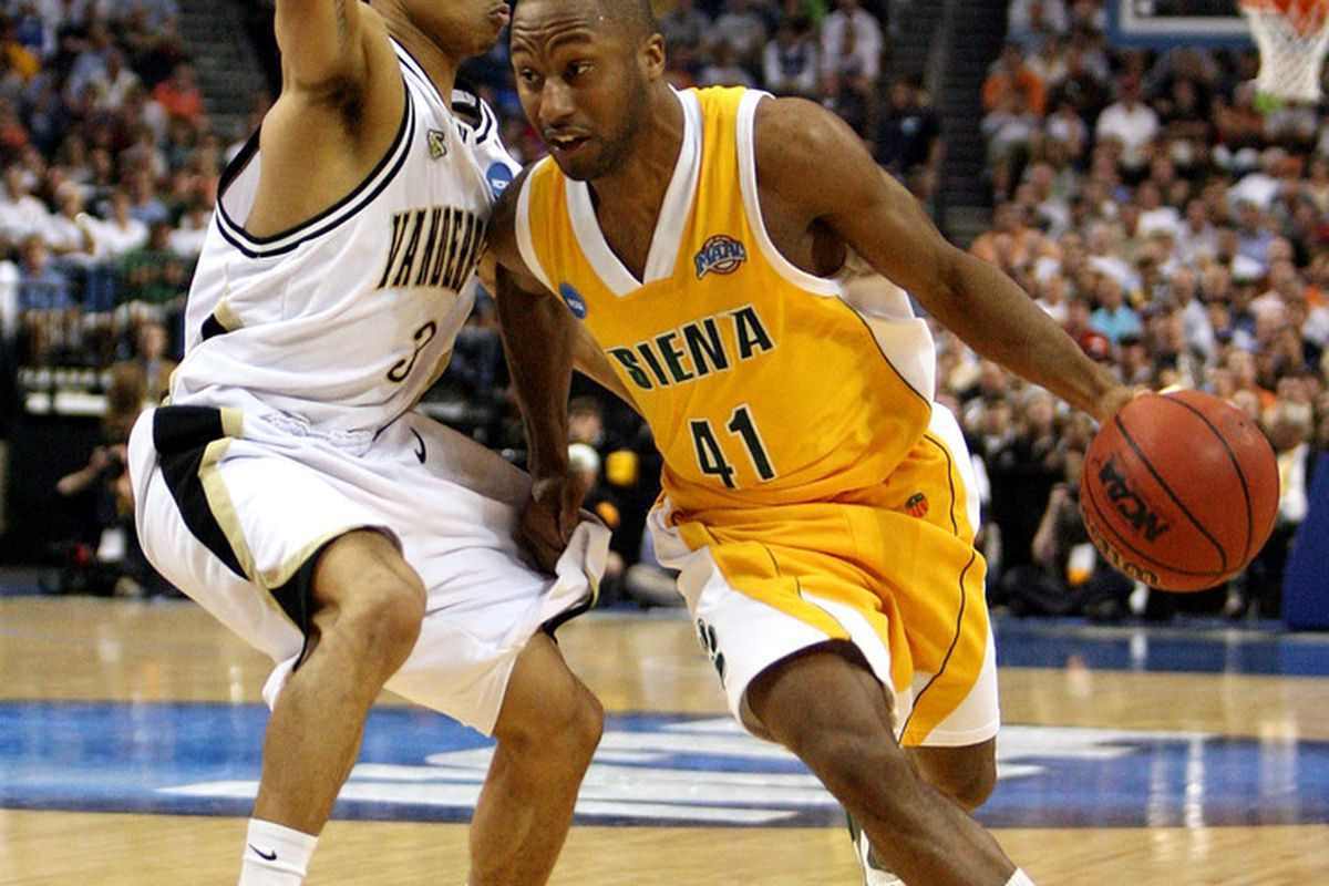Kenny Hasbrouck drives past a Vanderbilt defender while in college at Siena.