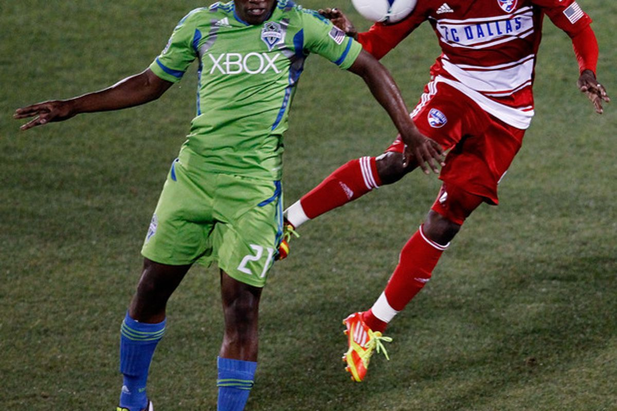 FRISCO, TX - MAY 09:  Jair Benitez #5 of the FC Dallas heads the ball against Cordell Cato #21 of the Seattle Sounders FC at FC Dallas Stadium on May 9, 2012 in Frisco, Texas.  (Photo by Tom Pennington/Getty Images)