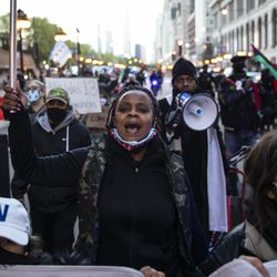 Dozens of protesters march down Michigan Avenue in the Loop after the city of Chicago released the videos of 13-year-old Adam Toledo being fatally shot by a Chicago police officer, Thursday evening, April 15, 2021. Toledo was shot to death by an officer on March 29 in an alley west of the 2300 block of South Sawyer Avenue in Little Village on the Southwest Side.