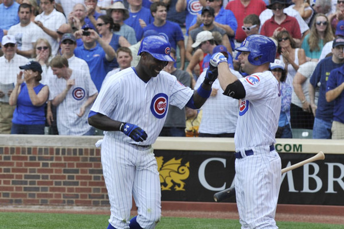 Alfonso Soriano of the Chicago Cubs gets congratulated by Reed Johnson after hitting a solo home run against the San Diego Padres at Wrigley Field in Chicago, Illinois.  (Photo by David Banks/Getty Images)