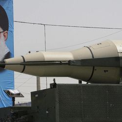 A Sajjil missile is displayed by Iran's Revolutionary Guard, in front of a portrait of the Iranian supreme leader Ayatollah Ali Khamenei, during a military parade commemorating the start of the Iraq-Iran war 32 years ago, in front of the mausoleum of the late revolutionary leader Ayatollah Khomeini, just outside Tehran, Iran, Friday, Sept. 21, 2012.