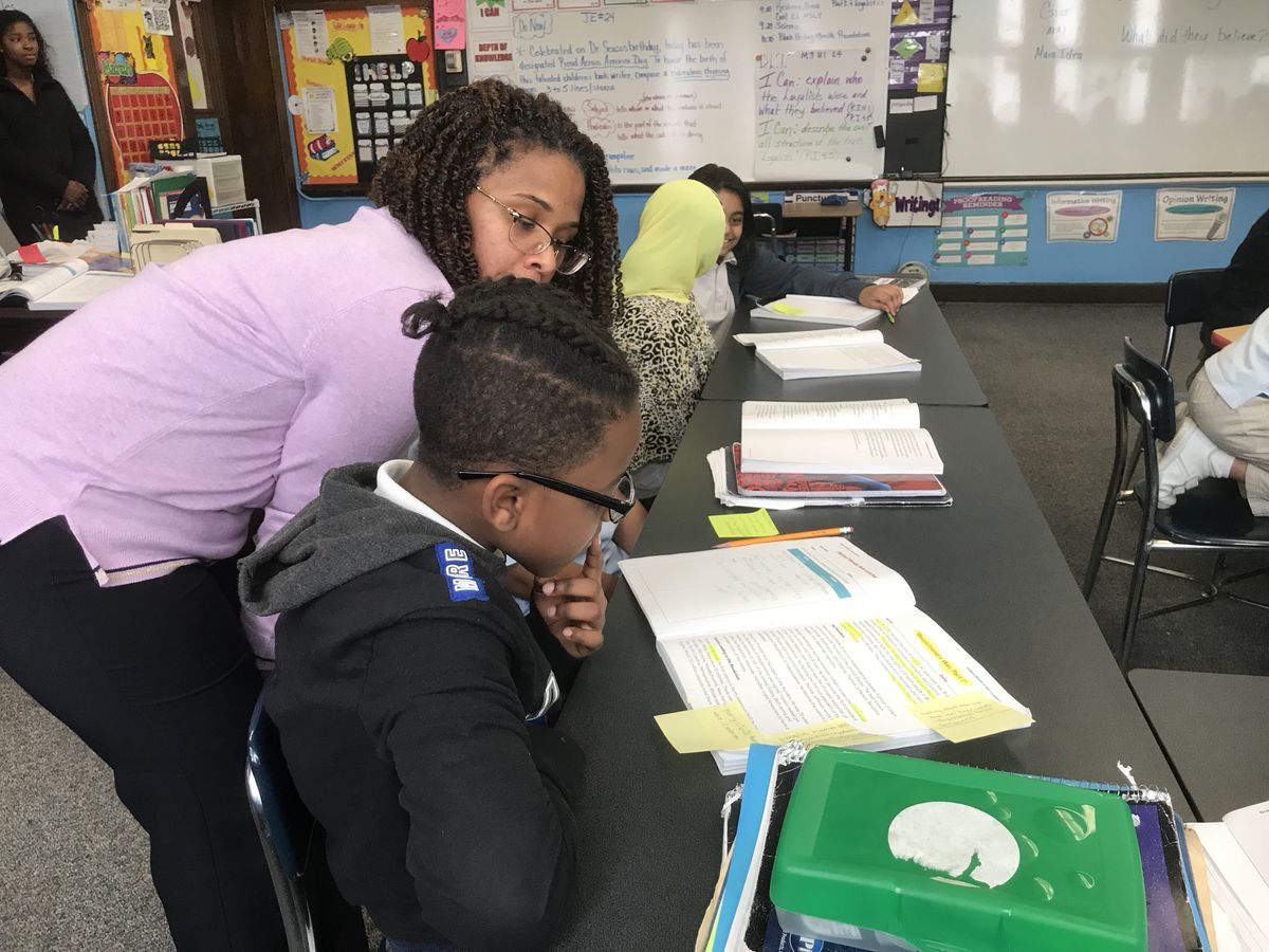 Kenya Posey stops to give one-on-one help to a student during a recent lesson.