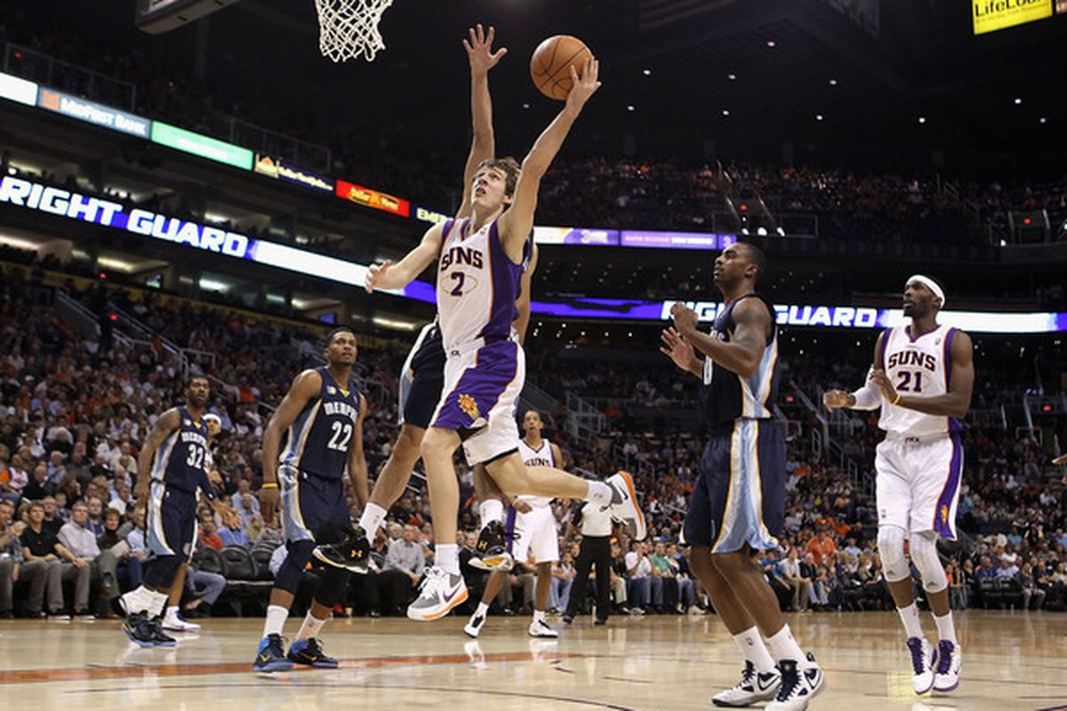 PHOENIX - DECEMBER 08:  Goran Dragic #2 of the Phoenix Suns drives to the basket against the Memphis Grizzlies during the NBA game at US Airways Center on December 8 2010 in Phoenix Arizona.    (Photo by Christian Petersen/Getty Images)
