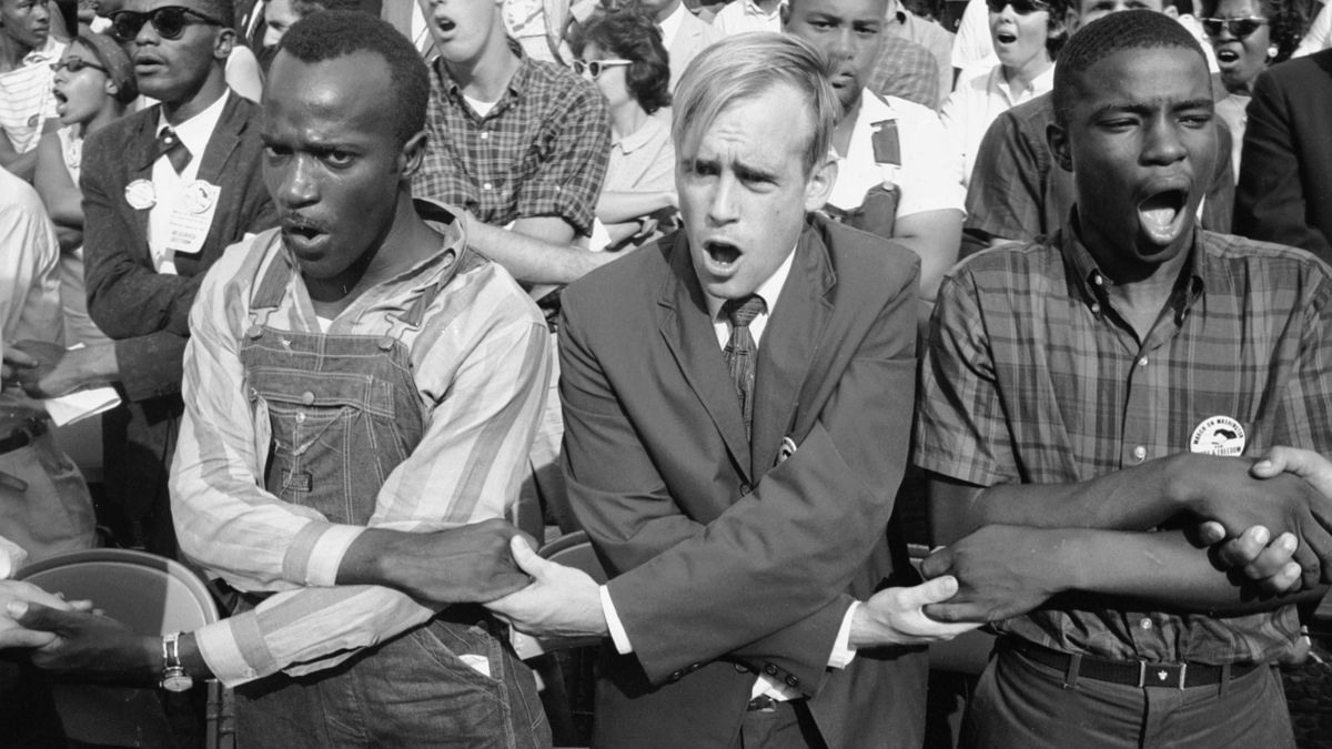 People holding hands and singing during the march on washington for jobs and freedom washington dc august 23 1963 photo paul schutzer the life picture
