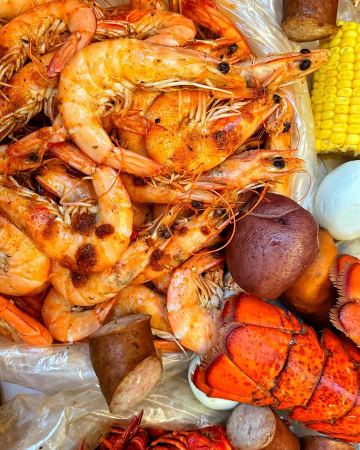 A pile of shrimp, lobster, and other seafood