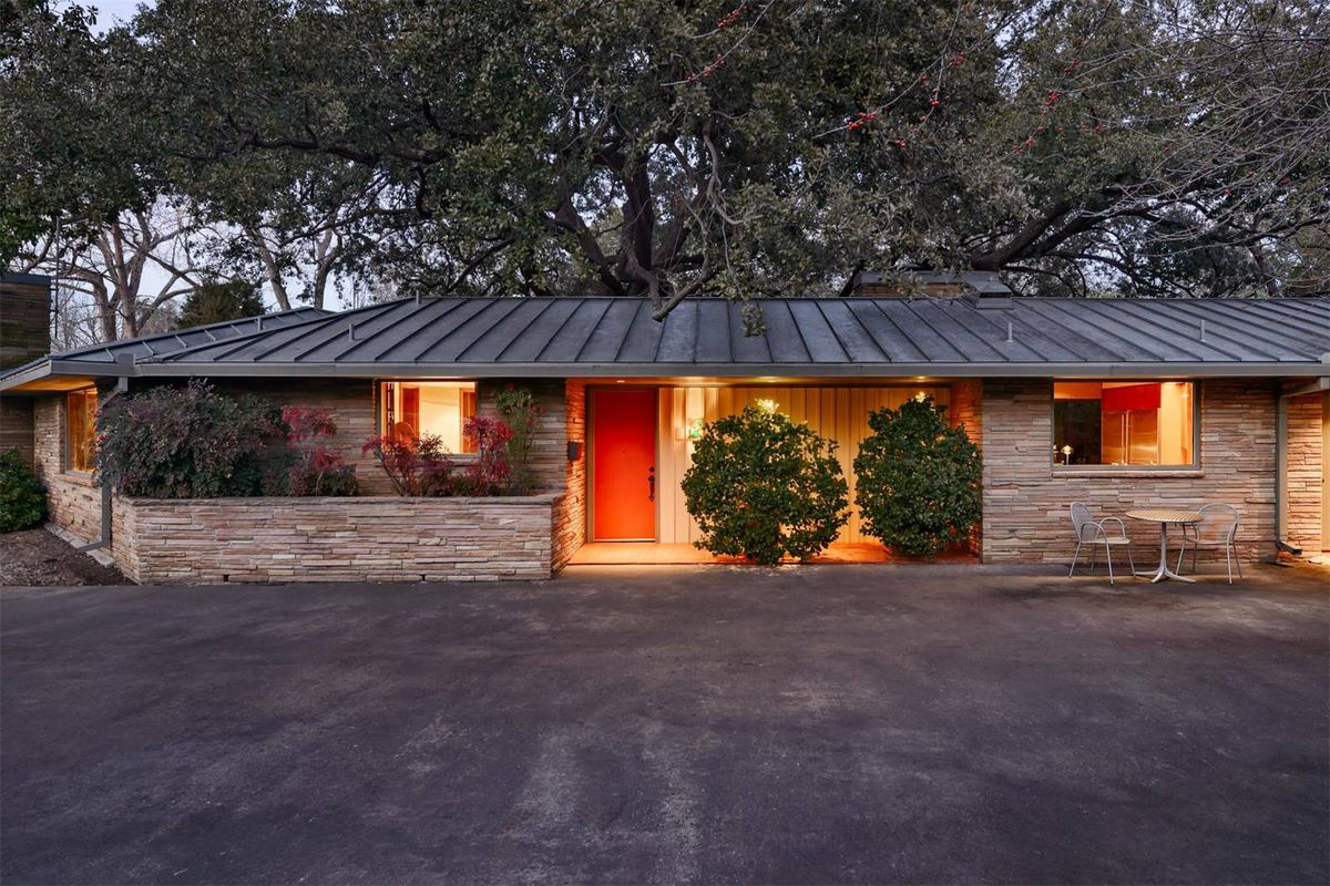 Low-profile ranch-style home with flagstone facade.