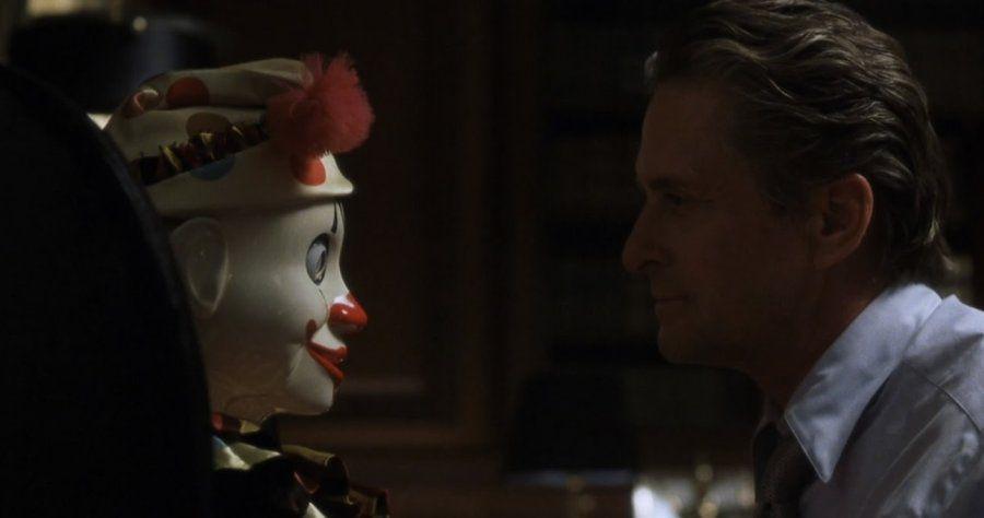 Michael Douglas as banker Nicholas Van Orton staring at a creepy porcelain puppet in The Game