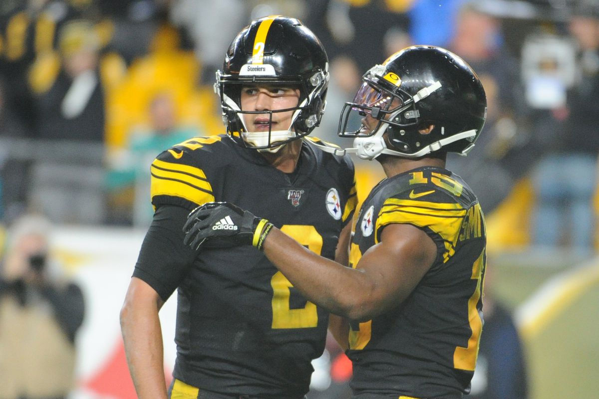 Pittsburgh Steelers quarterback Mason Rudolph and wide receiver JuJu Smith-Schuster celebrate a touchdown against the Miami Dolphins during the third quarter at Heinz Field.