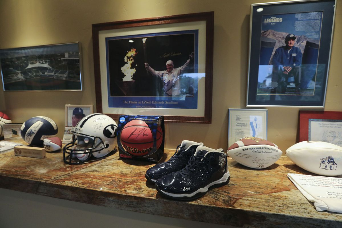 BYU sports memorabilia, including Jimmer Fredette's shoes, are on display in Sy Kimball's home in Provo on Monday, Oct. 11, 2021. Kimball is one of the largest donors to BYU sports.