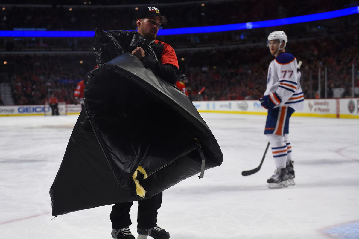 The Chicago Ice Crew cleans up debris on the ice