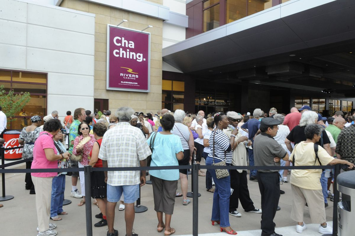 Gamblers wait for the grand opening of the Rivers Casino in Des Plaines in 2011.