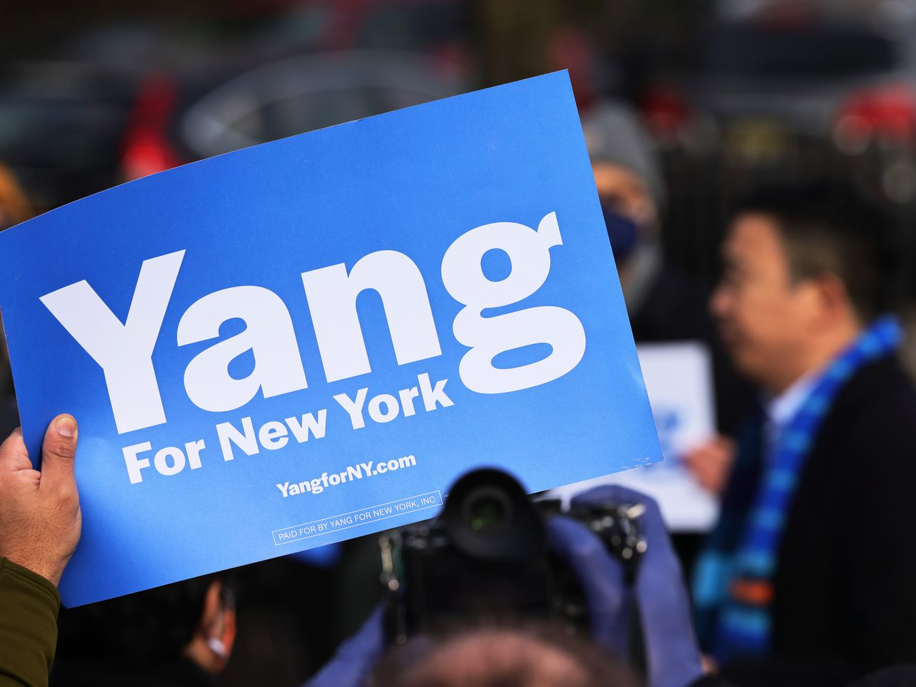"""A blue sign reading """"Yang for New York"""""""