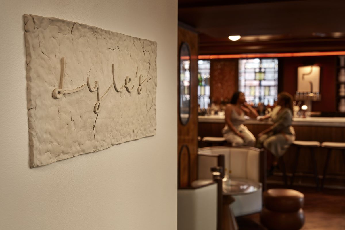Lore Group creative director Jacu Strauss molded a sign at Lyle's out of clay.