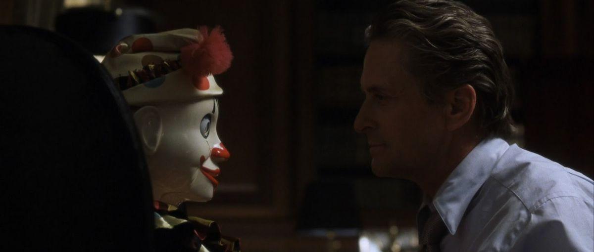 michael douglas stares down a spooky clown