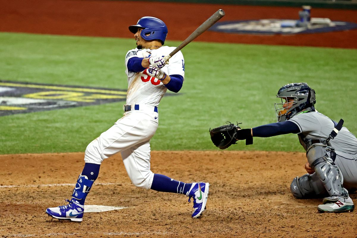 Los Angeles Dodgers right fielder Mookie Betts (50) hits a home run during the eighth inning against the Tampa Bay Rays during game six of the 2020 World Series at Globe Life Field.