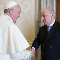 In this photo provided by the Vatican paper L'Osservatore Romano, Pope Francis welcomes maestro Daniel Barenboim at the Vatican, Monday, Nov. 17, 2014. Pope Francis is seeking to reassure the church's right-wing base that he's not a renegade bent on changing church doctrine on family issues — weeks after a Vatican meeting of bishops initially proposed a radical welcome for gays and divorced Catholics.