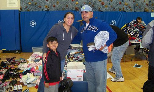 A family received donated items at Greeley's Bella Romero Elementary School, where nearly 300 students were classified as homeless after the flooding. <em>Photo courtesy of Theresa Myers.</em>
