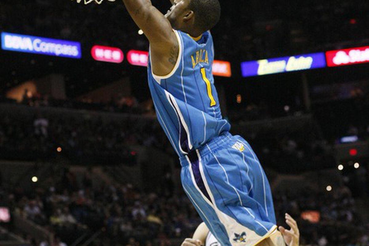 Apr 6, 2012; San Antonio, TX, USA; New Orleans Hornets forward Trevor Ariza (1) dunks during the second half against the San Antonio Spurs at the AT&T Center. The Spurs won Mandatory Credit: Soobum Im-US PRESSWIRE