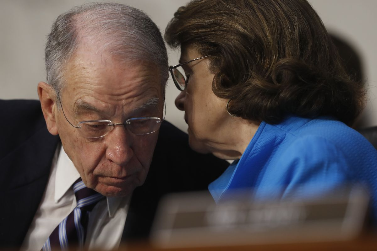 Senate Judiciary Committee Chairman Sen. Charles Grassley, R-Iowa,  confers with the committee's ranking Democratic member, Sen. Dianne Feinstein, D-Calif., on Monday during the committee's confirmation hearing for Supreme Court nominee Neil Gorsuch. | Pa
