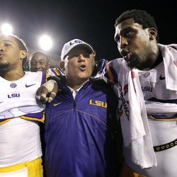 In this Sept. 8, 2012 photo, LSU defensive end Sam Montgomery, right, sings the LSU Alma Mater with head coach Les Miles and cornerback Jalen Collins, left, after their NCAA college football game against Washington in Baton Rouge, La.