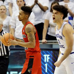 Brigham Young Cougars guard Elijah Bryant (3) reacts after causing Illinois State Redbirds forward Phil Fayne (10) to travel with the ball as BYU and Illinois State play in an NCAA men's basketball game in Provo on Wednesday, Dec. 6, 2017. BYU won 80-68.