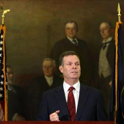 Embattled Utah Attorney General John Swallow announces his resignation at the Capitol in Salt Lake City on Thursday, Nov. 21, 2013. Swallow cut a deal with the lieutenant governor's office to resign in order to avoid facing criminal charges. A report from the special counsel the office hired to investigate alleged election law violations recommended that Swallow be charged with three misdemeanors, a source said. In lieu of the criminal charges, the office negotiated a deal calling for only civil sanctions if Swallow would step down. The deal would prevent his election from being invalidated in a court action and his office from being up for grabs in a special election.