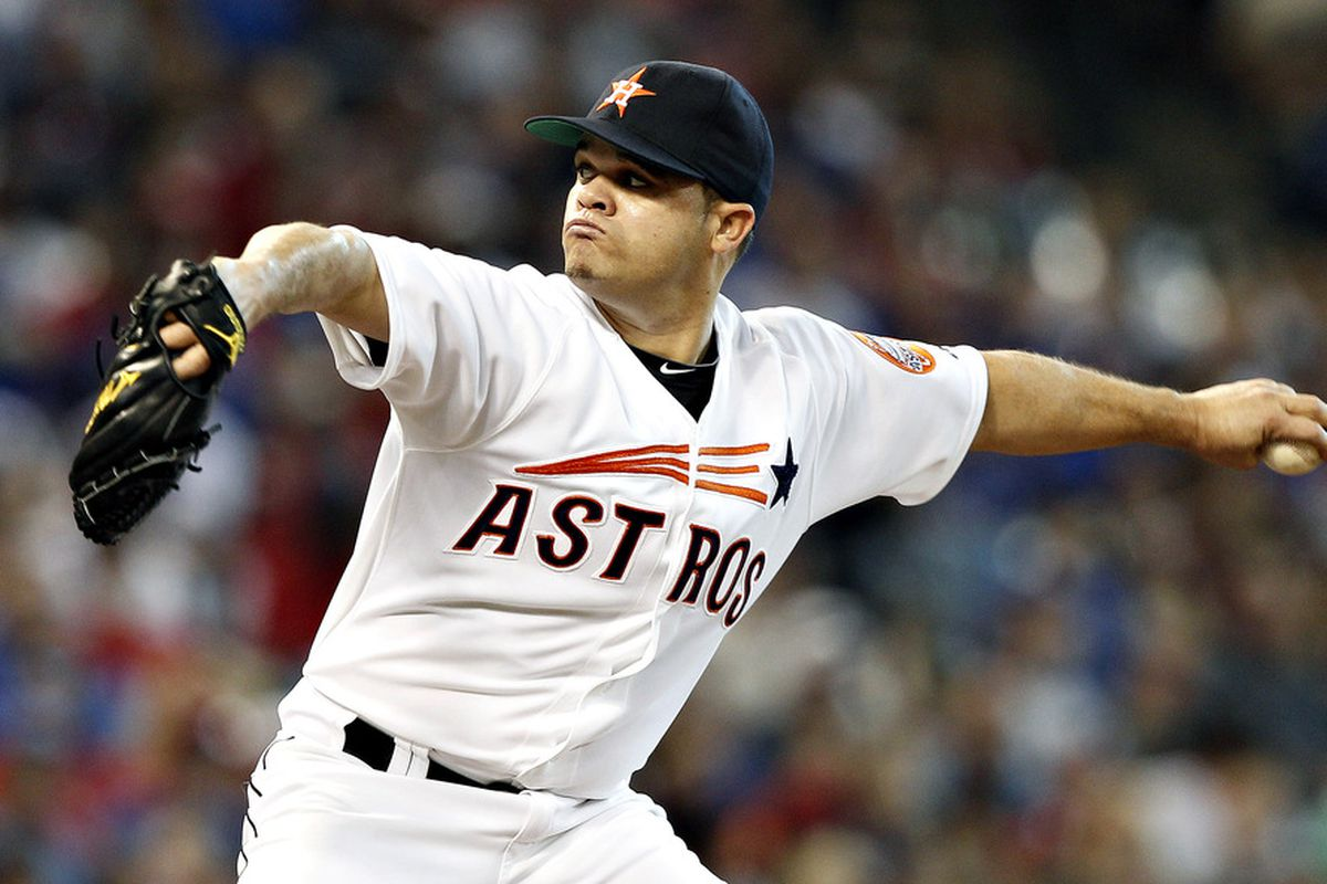 HOUSTON - MAY 18:  Wandy Rodriguez #51 of the Houston Astros throws against the Texas Rangers at Minute Maid Park on May 18, 2012 in Houston, Texas.  (Photo by Bob Levey/Getty Images)