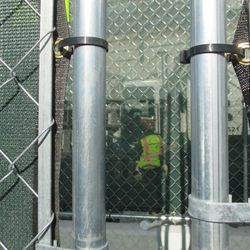 1:03 p.m. Another view through a gap in the fence, obstructed by more fences, in front of the ballpark -