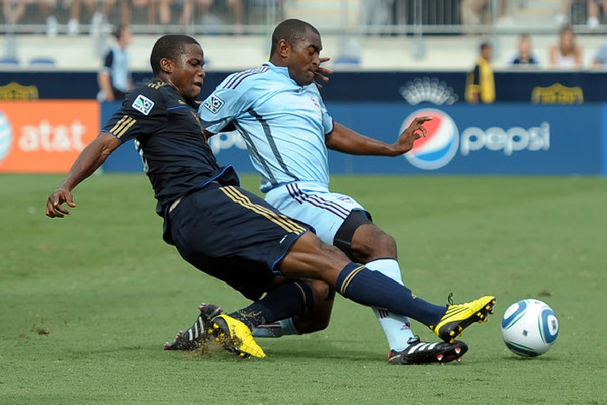 CHESTER PA - AUGUST 14:  Danny Mwanga #10 of the Philadelphia Union takes a shot on goal around Marvell Wynne #22 of the Colorado Rapids at PPL Park on August 14 2010 in Chester Pennsylvania.  (Photo by Drew Hallowell/Getty Images)
