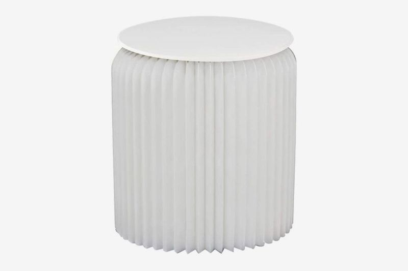 Round stool with pleats.