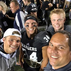 From left to right, brothers Zach Wilson, Josh Wilson and Micah Wilson pose for a photo with their father, Mike Wilson, front right.