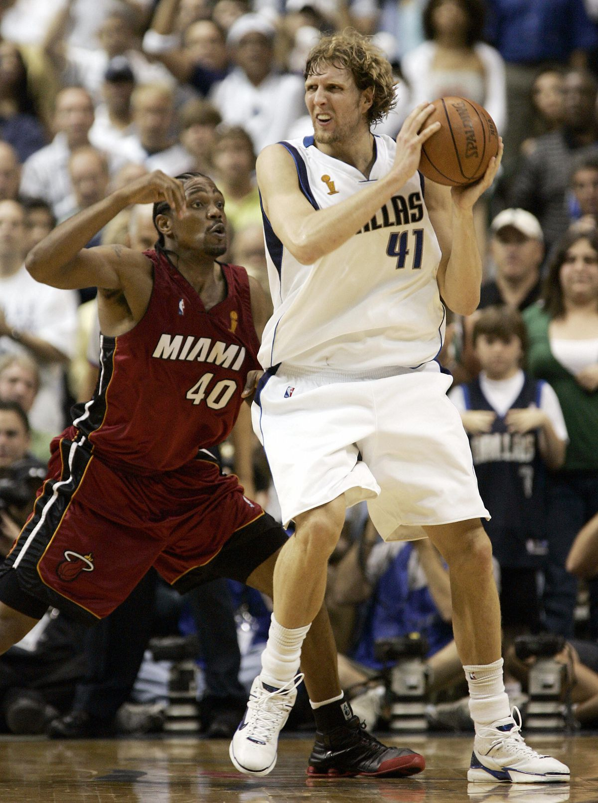 Udonis Haslem (L) of the Miami Heat guar