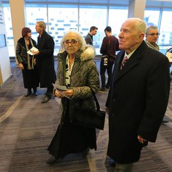 Jo and Glen Tuckett enter the memorial for former BYU football coach Lavell Edwards at the Provo Convention Center on Friday, Jan. 6, 2017.