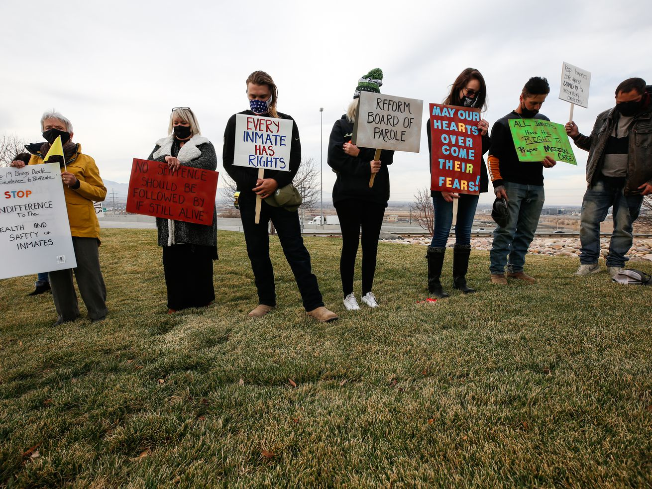 Demonstrators gather for an inmate rights rally outside of the Utah Department of Corrections in Draper on Sunday, Nov. 22, 2020. During the rally, participants planted green flags in the lawn for all the incarcerated individuals that have tested positive with COVID-19.