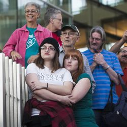 People listen and take photos during a same sex marriage celebration at Library Square in Salt Lake City, Monday, Oct. 6, 2014.