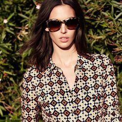 "<A href=""http://www.toryburch.com/Framed/framed,default,pd.html?start=7&cgid=newarrivals-lookbook"">Classic cat-eye sunglasses and Brigitte blouse</a>"