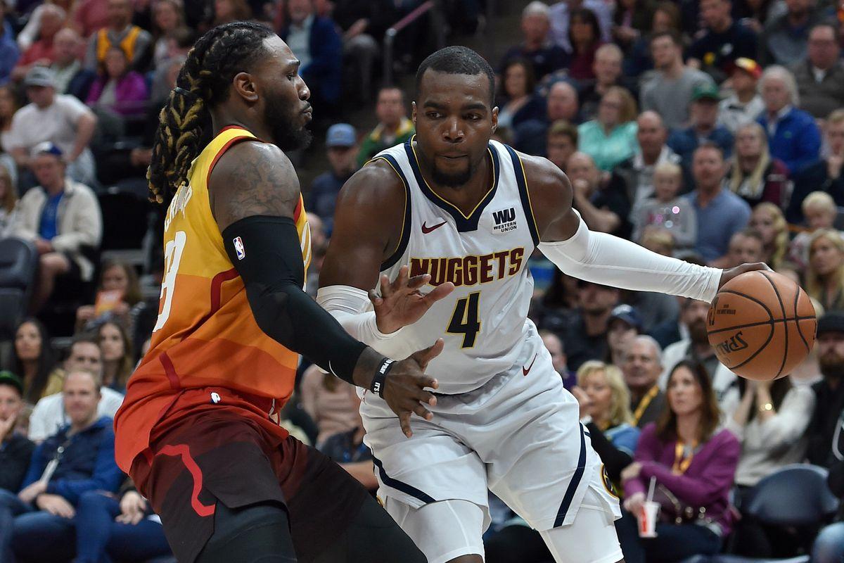 Paul Millsap of the Denver Nuggets drives around Jae Crowder of the Utah Jazz in the second half of a NBA game at Vivint Smart Home Arena on April 09, 2019 in Salt Lake City, Utah.