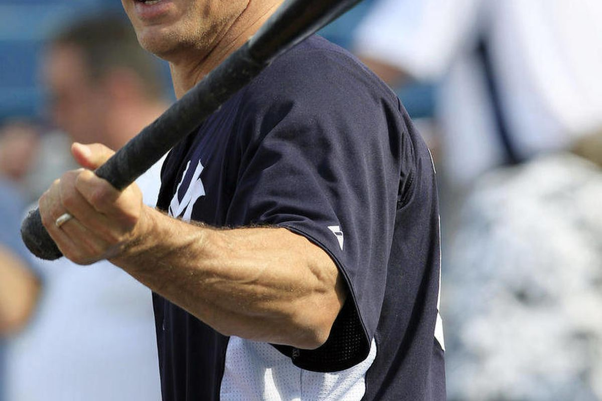 New York Yankees manager Joe Girardi swings a bat over his shoulder during batting practice before a spring training baseball game against the Philadelphia Phillies at Steinbrenner Field in Tampa, Fla., Friday, March 30, 2012.