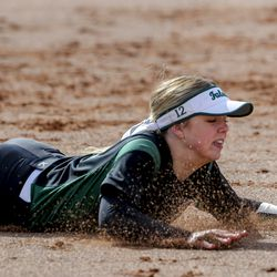 Clearfield shortstop Miranda Mansfield makes a diving catch during a game against Bountiful at Millcreek Junior High School in Bountiful on Wednesday, March 24, 2021.