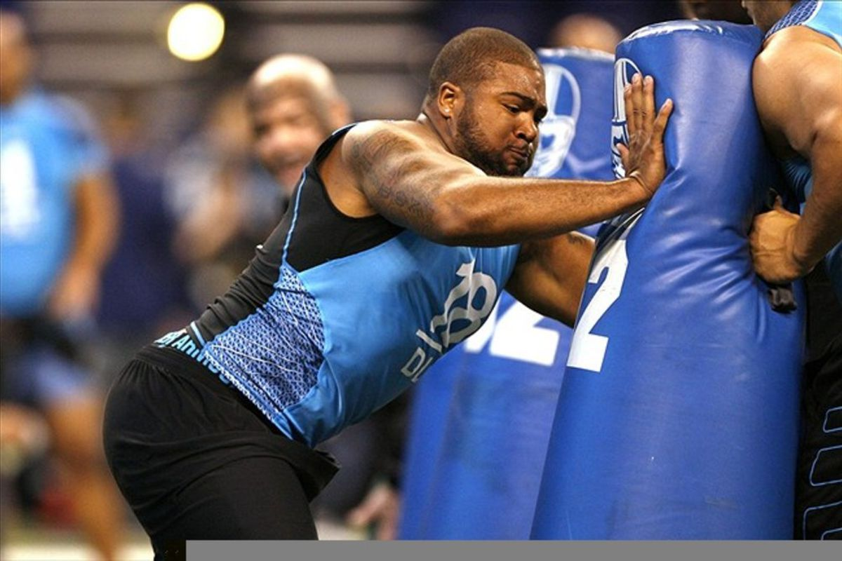 Feb 27, 2012; Indianapolis, IN, USA; California defensive lineman Trevor Guyton hits the tackling dummy during the NFL Combine at Lucas Oil Stadium. Mandatory Credit: Brian Spurlock-US PRESSWIRE