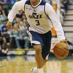 Trey Burke dribbles the ball during the Utah Jazz's scrimmage in Salt Lake City, Saturday, Oct. 5, 2013.