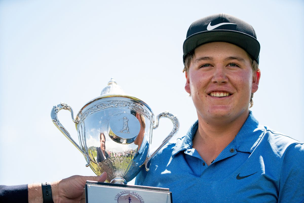 Preston Summerhays accepts his trophy after beating Chase Lansford in the Utah State Amateur Championship finals at Soldier Hollow Golf Course in Midway on Saturday, July 13, 2019.