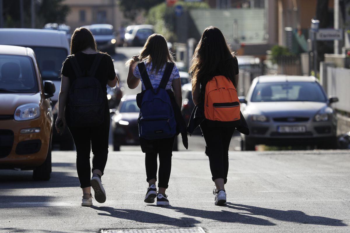 Elena Maria Moretti, 12 (center), walks with friends to school in Rome.