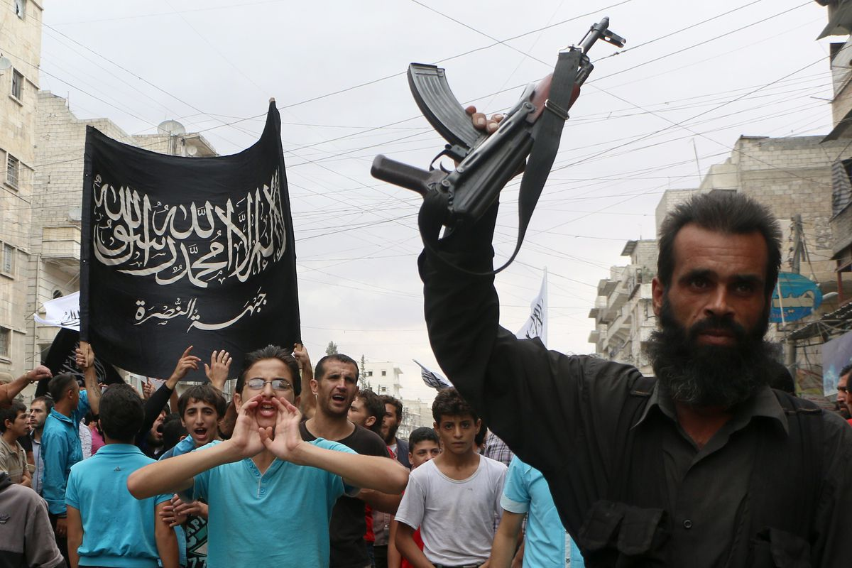 Supporters of Jabhat al-Nusra rally in Aleppo, Syria