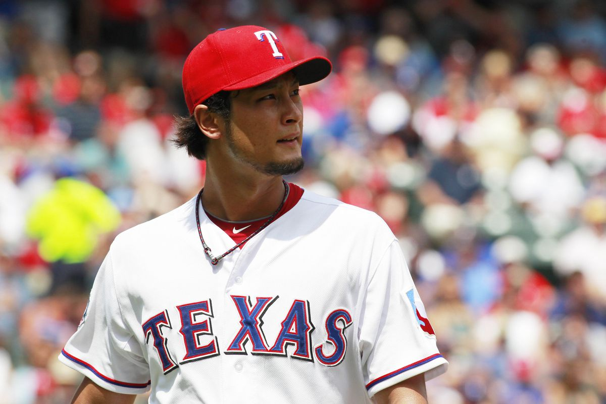 Aug 12, 2012; Arlington, TX, USA; Texas Rangers starting pitcher Yu Darvish (11) watches a replay during the fourth inning of the game against the Detroit Tigers at Rangers Ballpark. Mandatory Credit: Tim Heitman-US PRESSWIRE