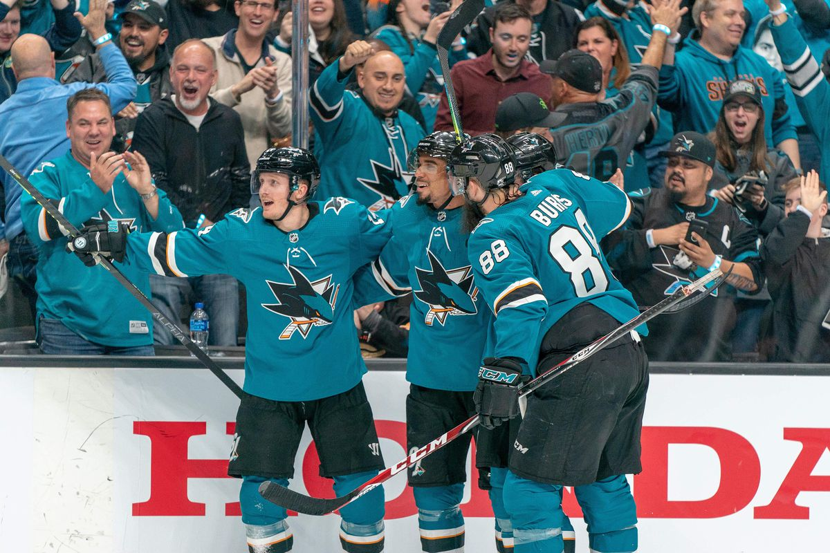 San Jose Sharks left wing Evander Kane, Sharks defenseman Brent Burns and Sharks center Gustav Nyquist celebrate during the second period against the Vegas Golden Knights in game one of the first round of the 2019 Stanley Cup Playoffs.